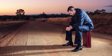 Concept: A frustrated business man is leaving the corporate lifestyle and chasing freedom in the outback of Queensland, Australia. Cinematic Portrait Style.