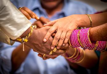 Hindu wedding couples holding hands