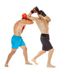 Kickboxers sparring on white