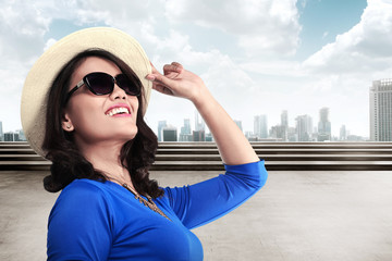 Tourist woman wearing hat and sunglasses