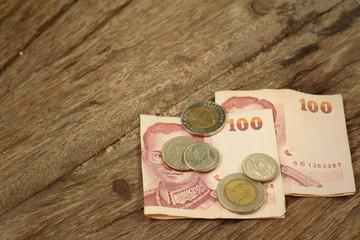 Thailand baht banknotes with Thailand baht coins.