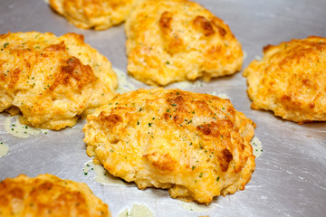 hot and fresh homemade biscuits on metal plate
