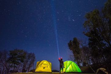 camp in forest at night with star