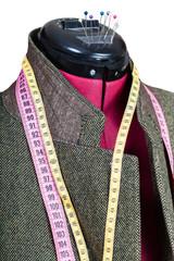 tailoring of man tweed jacket on mannequin