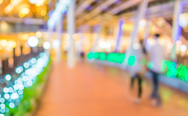 Fotomurales - blur image of people walking at corridor on night time with boke