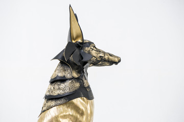sculpture of the Egyptian god Anubis, gold figure and black jack