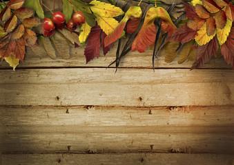 Autumn leaves border on vintage wooden background