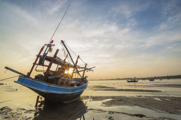 Sunset and Thai boat in Hua Hin Thailand