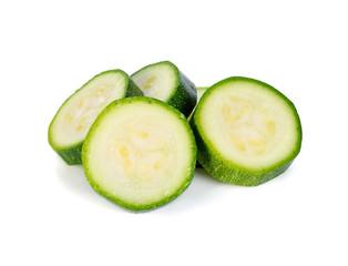 fresh zucchini slices on white background
