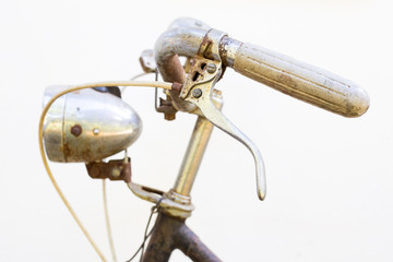 Retro styled image of a nineteenth century bike with lantern iso
