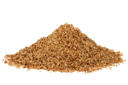 Heap of organic brown coconut palm sugar, isolated on white background.