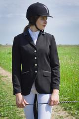Beautiful girl jockey dressing uniform