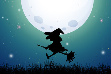 Silhouette witch on broom