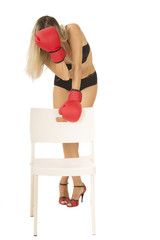 woman with red boxing gloves and red shoes