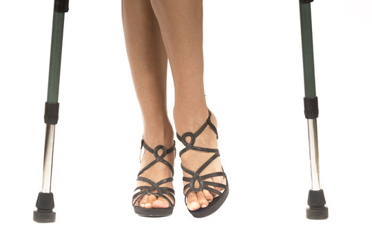 woman with high shoes on crutches