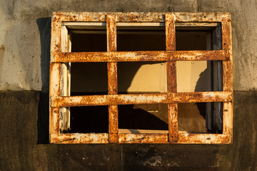 Rusty iron bars on the window