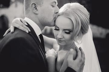 blonde bride with her groom