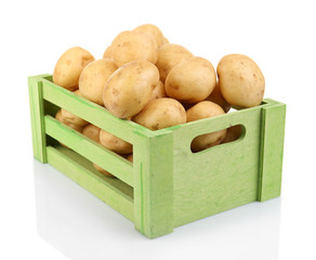 New potatoes in wooden table isolated on white