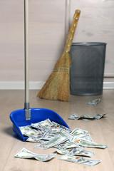 Dollars in garbage scoop in room