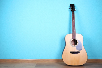 Classical guitar on blue wallpaper background