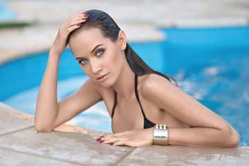 portrait of a beautiful young girl in a swimsuit