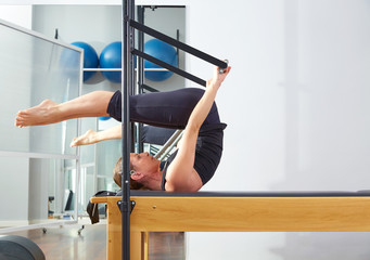 Pilates woman in reformer roll over exercise