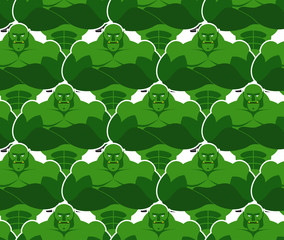Green monsters seamless pattern. Evil and powerful Goblins. Vekt