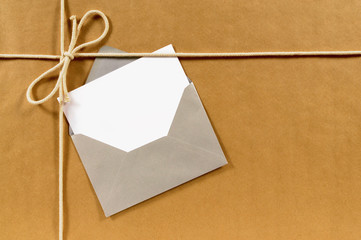 Brown paper parcel with silver envelope
