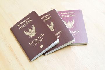Thailand passports on wooden background