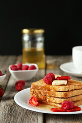 Fresh toast with raspberry and strawberry on grey wooden backgro