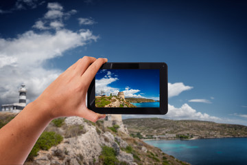 Tablet in hand photo shooting Mediterranean coast - these are all photos made by me, that you separately can find on my fotolia portfolio.