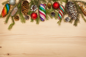 Christmas tree with toys, Christmas colored bumps. Leaving space for the inscription on a wooden surface