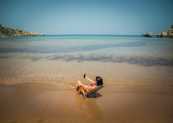 Woman sitting in a chair at the beach