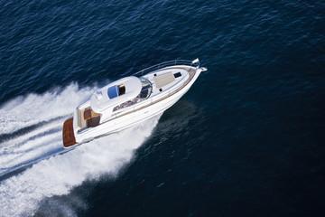Fast motor boat sailing through an ocean
