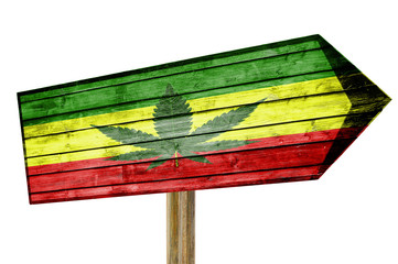 Rasta Flag With Marijuana Leaf wooden sign isolated on white