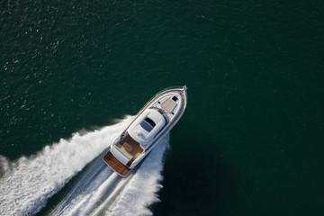 Speed boat sailing through a deep sea