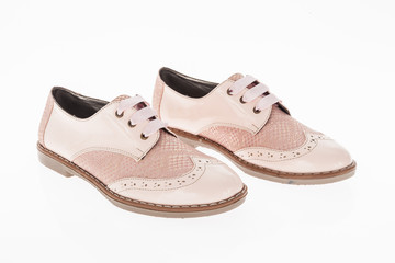 shoe made of pink leather with laces for women on white background