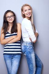 Fashionable young girls posing.