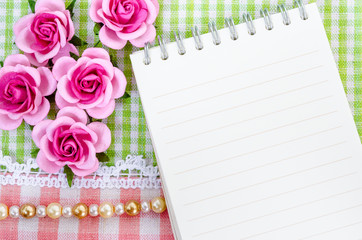 Open diary and pink roses