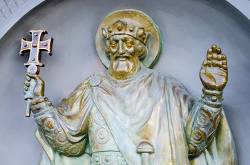 Bronze sculpture on the wall of christian holy man