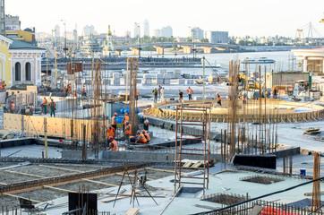 Construction site building in city center, bridge building at sunset