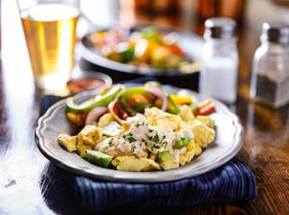 Wall Mural - mexican breakfast fajita scrambled eggs with avocado and cream fresca