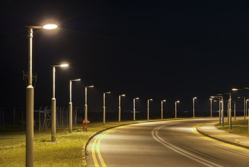 Street light and empty street at night