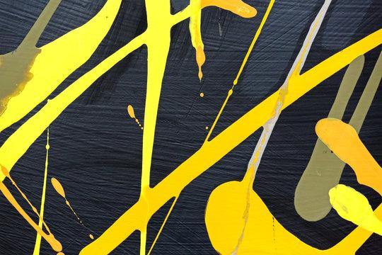 yellow paint splashes over black background