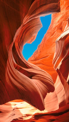 Up to blue sky in slot canyon. The Magic Antelope Canyon in the Navajo Reservation, Arizona
