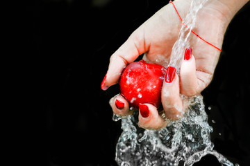 hand and splash fruit
