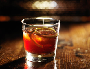 sazerac cocktail on dark wooden background