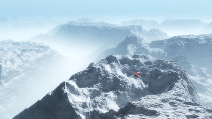 Red private airplane over misty winter mountain landscape.