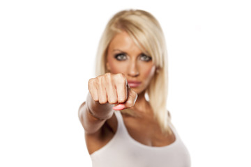 serious young blonde showing fist
