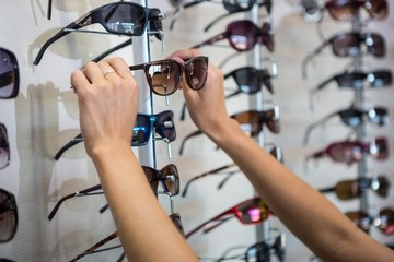 Woman picking out new sunglasses